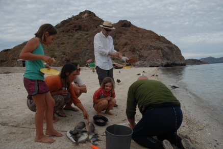 Jamie and RK draw a crowd while cleaning their catch.
