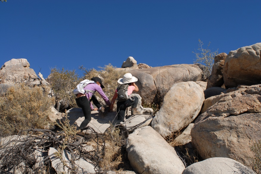 Scrambling to the top of a ridge in Catavina.