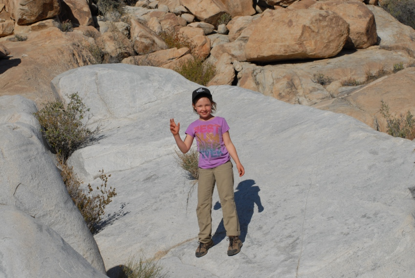 Leonie discovers a rock slide, maybe 30 feet long, into a pool.