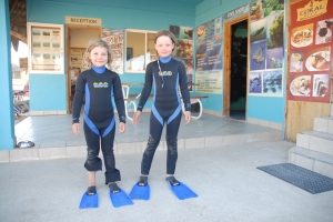 After watching me pull these things on for years for open water swims, the ladies finally get suits of their own...
