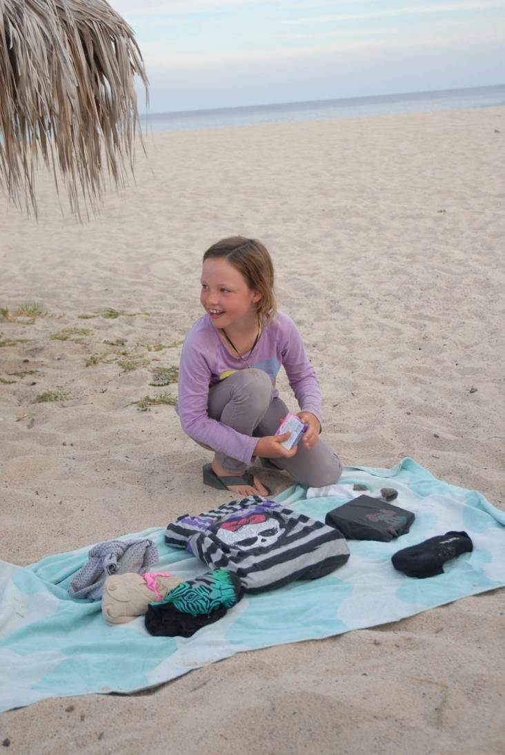 Opening presents on the beach, and clearly delighted.