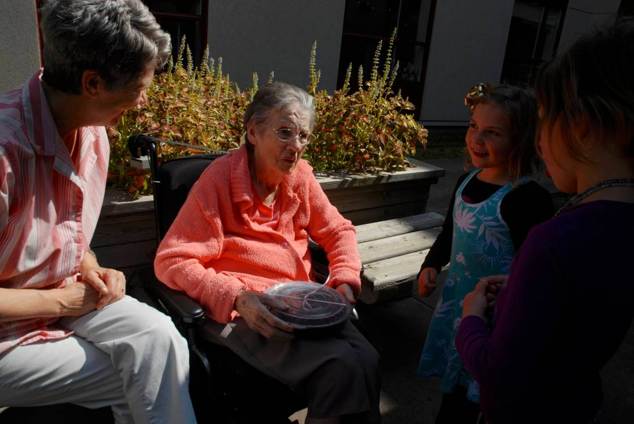The girls give their great granny a tray of brownies they made for her in September, 2013. Three generations of women in that photo (my mom is on the left).