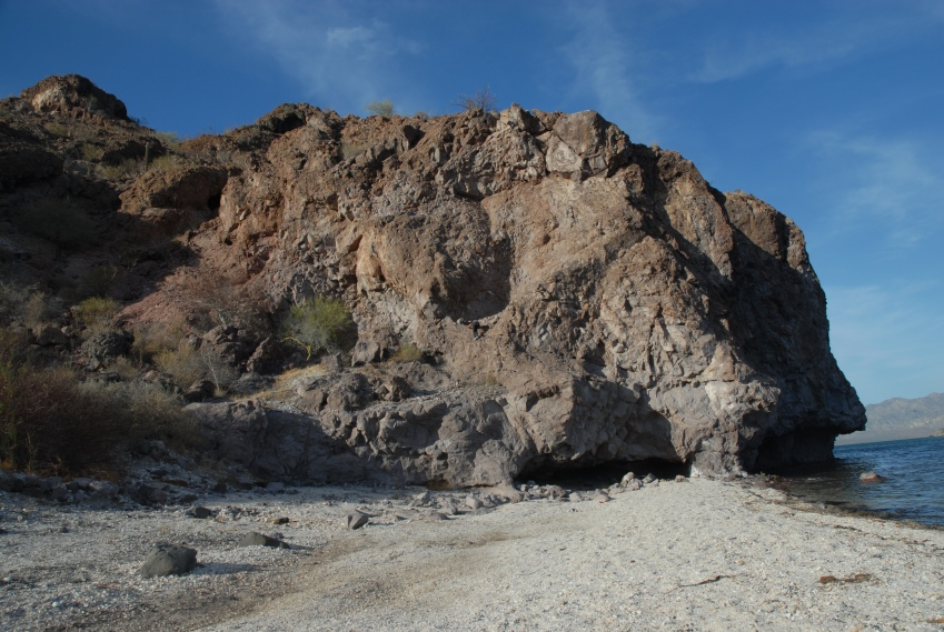 The north end of the beach is sheltered by this tall rock point of scaly, crumbly stuff - totally unsafe to climb.