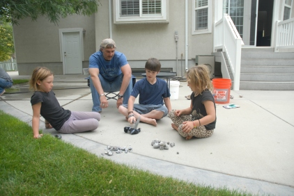 Matt, his son Ethan, and the girls about to get Medieval on a bunch of geodes that Tracey identified while on a hike.