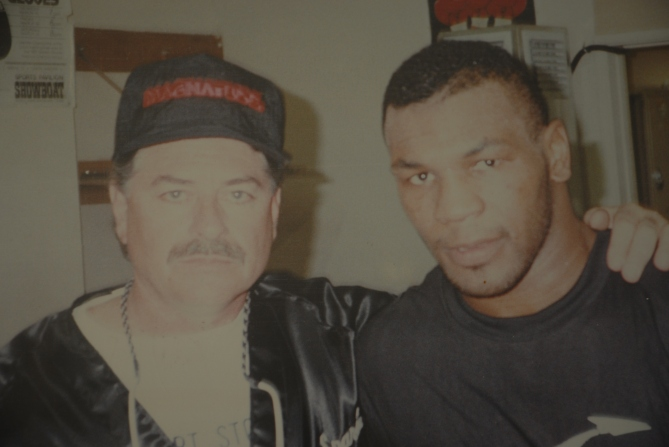 Pictured here is a man who can kill you with his bare hands, and standing next to him is Mike Tyson.
