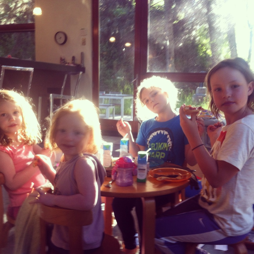 The ladies enjoy a sun-dappled breakfast in Aspen with new pals Lila and Louisa.