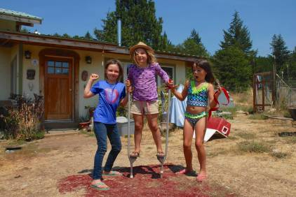Abbie teaches the girls how to use her stilts.