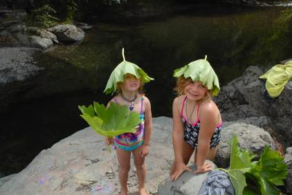 Sylvie and Arabella at the swimming hole with their... um... new hats.